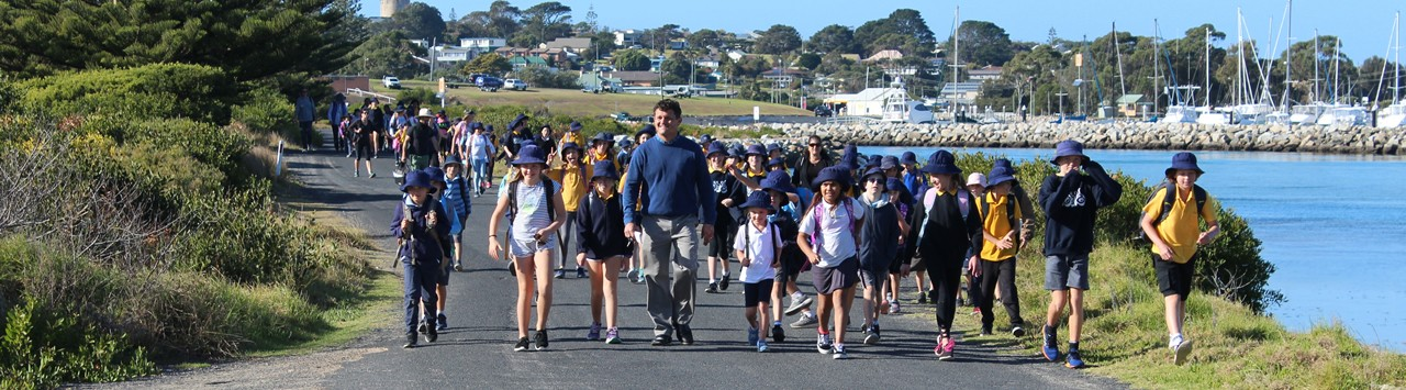 Principal and students on a walkathon.